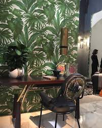 only versace could make green palmtree wallpaper look stylish
