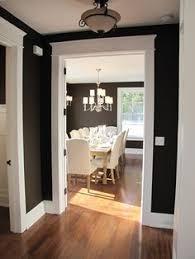 black walls maybe even just dark dark gray white trim rich