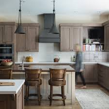 what backsplash goes with brown cabinets 75 beautiful kitchen with brown cabinets and subway tile