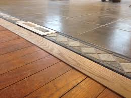 threshold tile to wood floor in open concept living room and