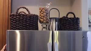top of fridge storage video how to decorate the top of the fridge for storage ehow