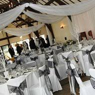 black and white chair covers chair cover hire sash bows hire wedding table swagging venue