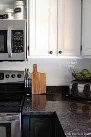 how to install tile backsplash in kitchen kitchen update smart tile backsplash house of four