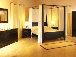 queen size black canopy bed frame amys office gothic black bedroom set with canopy bed also white curtains plus yellow lighting decorating idea