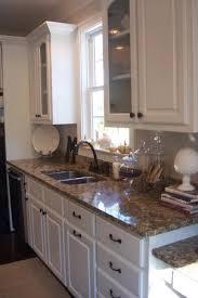 granite countertops with white cabinets santa cecilia granite traditional kitchen