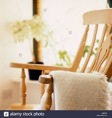A Rocking Chair A Nice Lifestyle Image With A Rocking Chair And Woolen Throw In