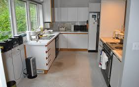 Can You Spray Paint Kitchen Cabinets by Refinish Laminate Cabinets Before And After