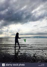 young boy sea fishing silhouette stock photos u0026 young boy sea