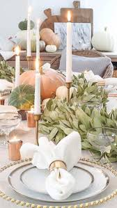 beautiful thanksgiving table setting in gold and copper candles