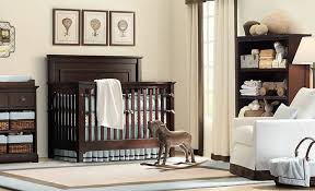 baby nursery with traditional furniture including white chair and