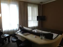 side design hotel hamburg room desk is the back side of bed note big windows picture of