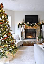 neutral christmas holiday home tour living room and fireplace