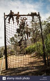 military soldiers climbing during obstacle course in boot