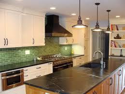 Black Soapstone Counters With Colorful Subway Tile Backsplash - Soapstone backsplash