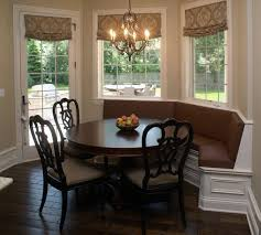 furniture chandelier with dark wood round table and wood chairs