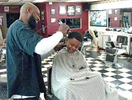 haircuts at the barbershop women african american black barbershops more than a haircut the durham voice