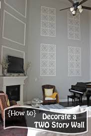 how to decorate a two story wall what to do with those crazy tall