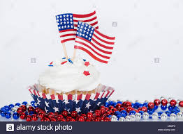 Why Is The American Flag Red White And Blue Patriotic Cupcake With Decorative American Flags And Red White