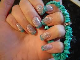 abstract turquoise nail design with mesh and flowers nail art