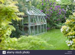 Greenhouse Windows by Greenhouse In Back Garden With Open Windows For Ventilation Stock