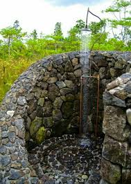 outdoor shower pebble floor home holiday house pinterest