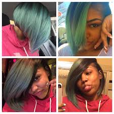 chin cut hairbob with cut in ends mint green hair with blue ends cut into a deep side part bob hair