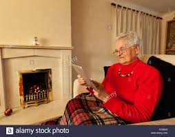 2 Person Armchair Old Woman Using An Ipad 2 Computer Tablet Sat In An Armchair