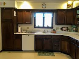 how to refurbish wood cabinets 15 diy kitchen cabinet makeovers before after photos of