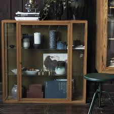 house doctor cabinet oak wood with two glass shelves living and co