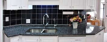granite countertop kitchens with dark wood cabinets glass tile