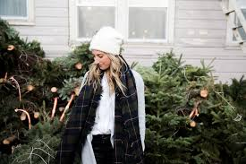 a visit to the christmas tree lot in a plaid scarf