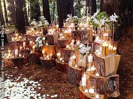 wedding backdrop set up enchanted forest wedding set up with tree stumps glowing candles
