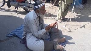 pakistani man legs weigh stone forced beg daily