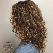 how to get loose curls medium length layers 28 gorgeous medium length curly hairstyles for women in 2018
