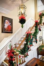 wooden stair handrail with garland using decorative