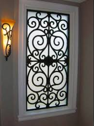 Decorative Grilles & Faux Wrought Iron Accents