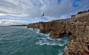 rocky shore wallpapers caves in the rocky ocean shore walldevil