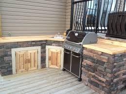 Outdoor Cabinets 101 Fireside Outdoor Kitchens by Outdoor Kitchen With Cedar U0026 Cultured Stone Www Thelittledecker Ca