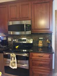 Copper Kitchen Backsplash by Cherry Cabinets Tan Brown Granite Counter Copper Rust Slate