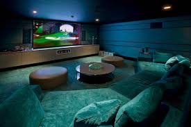 video game room design ideas with dim lights and theater interior