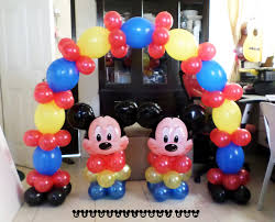 mickey mouse centerpieces with tall cake arch cebu balloons and