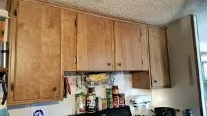 how to make cheap kitchen cabinets look better how to make cheap 70 s cabinets look nicer