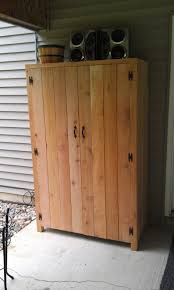 fantastic outdoor cedar storage cabinet with black butterfly with