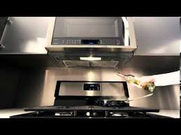 microwave with fan over the range whirlpool over the range microwave auto adapt fan youtube