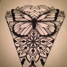gnarling animal muzzle with geometric butterfly wings tattoo
