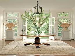 rounded pedestal table decor under iron lantern ceiling light for