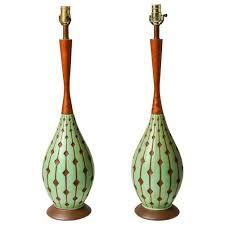 modern ceramic table lamps danish mid century modern style ceramic and teak lamp pair at 1stdibs