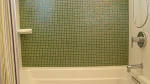 photos hgtv neutral and black mosaic pebble shower floor with