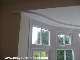 flexible curtain rods are good for bay windows or other areas where one straight rod won