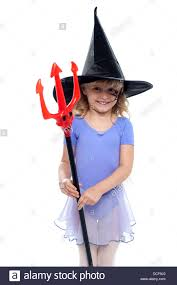 cowboy hat halloween cute holding pitchfork and wearing witches hat halloween